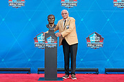 Aug 3, 2019; Canton, OH, USA; Johnny Robinson poses with bust during the Pro Football Hall of Fame Enshrinement at Tom Benson Hall of Fame Stadium. (Robin Alam/Image of Sport)