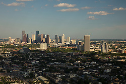 Western aerial view of downtown Houston, Texas skyline and adjacent neighborhoods.
