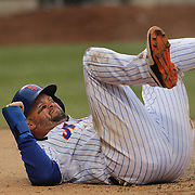 Michael Cuddyer, New York Mets, scores a run in the seventh inning as he slides across the plate beating catcher A.J. Pierzynski, Atlanta Braves, during the New York Mets Vs Atlanta Braves MLB regular season baseball game at Citi Field, Queens, New York. USA. 23rd April 2015. Photo Tim Clayton