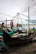 Boats and Chinese fishing nets lined up against the shores of Fort Kochi Seafront Promenade, Cochin, Kerala, Southern India
