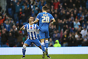 Brighton striker, Solomon March jumps to celebrate his goal with Brighton central midfielder, Beram Kayal during the Sky Bet Championship match between Brighton and Hove Albion and Milton Keynes Dons at the American Express Community Stadium, Brighton and Hove, England on 7 November 2015. Photo by Geoff Penn.