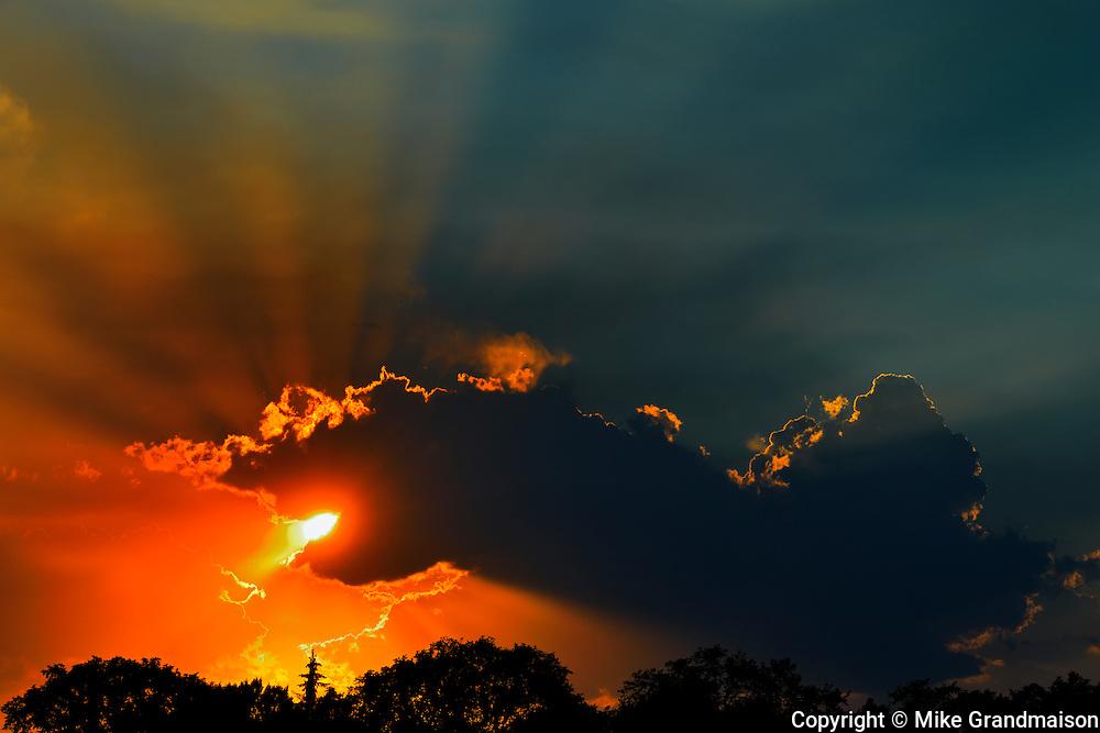 God rays or sunburst through the clouds<br /> Winnipeg<br /> Manitoba<br /> Canada
