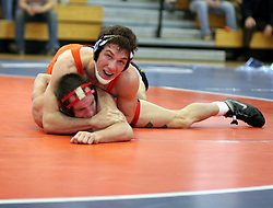 Drew DiPasquale wrestles Ohio State's J. Jaggers in a dual meet held at UVA.  DiPasquale lost the match and UVA fell to the Buckeyes 28-10.