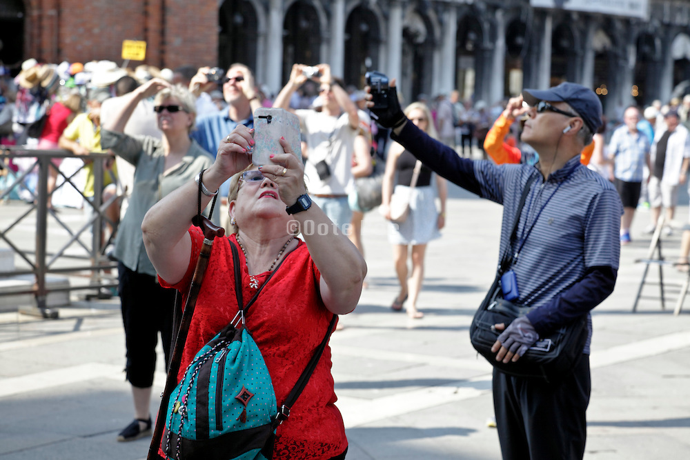 tourists snapping pictures St. Marks Square Venice Italy