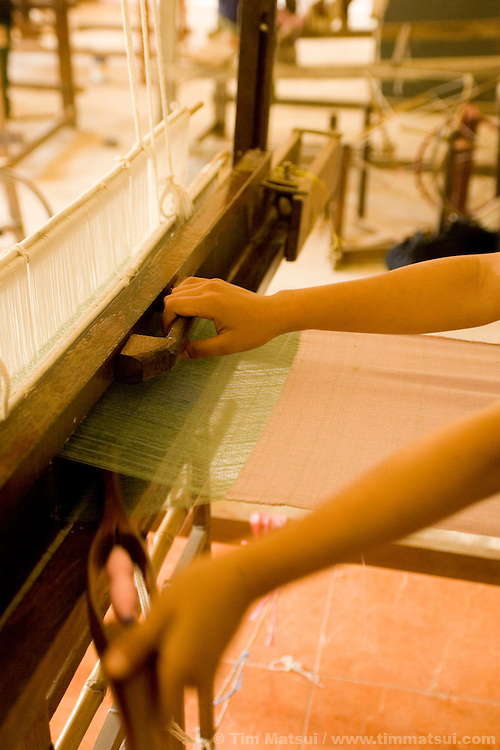 Working on a loom to make traditional woven goods for sale at the Non Governmental Organization DEPDC in Mae Sai, Thailand, on the border with Myanmar (Burma)...DEPDC is addressing the issue of human trafficking in northern Thailand by providing a safe place to live and study for youth who are at risk of being trafficked.