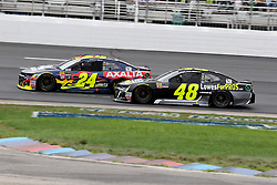 July 22, 2018 - Loudon, NH, U.S. - LOUDON, NH - JULY 22: (48) Jimmie Johnson and (24) William Byron  in turn 4 during the Monster Energy Cup Series Foxwoods Resort Casino 301 race on July, 21, 2018, at New Hampshire Motor Speedway in Loudon, NH. (Photo by Malcolm Hope/Icon Sportswire) (Credit Image: © Malcolm Hope/Icon SMI via ZUMA Press)