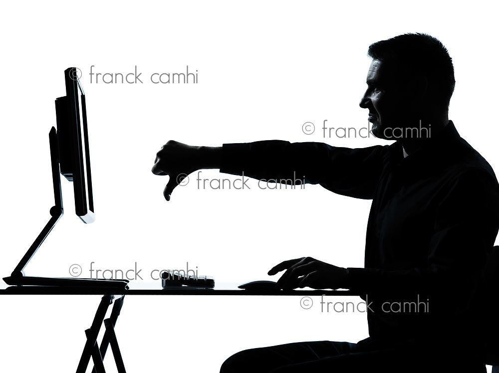 one caucasian business man computer computing thumb down displeased silhouette in studio isolated on white background