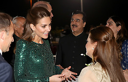 The Duchess of Cambridge speaks to guests during a reception hosted by the British High Commissioner to Pakistan Thomas Drew CMG at the National Monument in Islamabad during the second day of the royal visit to Pakistan.