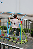 child exercising in public area in Shanghai China