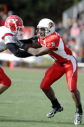 28 October 2006: Kye Stewart slows down a Penguin receiver. Youngstown State turned off over 15,000 fans as the win blew their way, cooling off Illinois State 27-13. Nationally ranked teams Youngstown State Penguins and Illinois State Redbirds competed at Hancock Stadium on the campus of Illinois State University in Normal Illinois.<br />