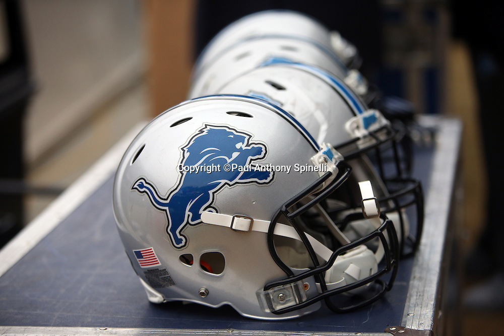 Four Detroit Lions helmets are lined up on a sideline trunk during the Detroit Lions NFL week 17 regular season football game against the Chicago Bears on Sunday, Jan. 3, 2016 in Chicago. The Lions won the game 24-20. (©Paul Anthony Spinelli)