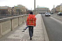 Man with skis and a backpack, Prague, Czech republic.