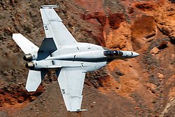 United States Navy Boeing F/A-18E Super Hornet (side 313) from the VFA-146 Blue Diamonds squadron flies low level on the Jedi Transition through Star Wars Canyon / Rainbow Canyon, Death Valley National Park, Panamint Springs, California, United States of America