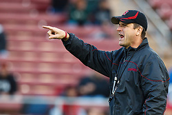 November 27, 2010; Stanford, CA, USA;  Stanford Cardinal head coach Jim Harbaugh instructs his team during warm ups before the game against the Oregon State Beavers at Stanford Stadium.
