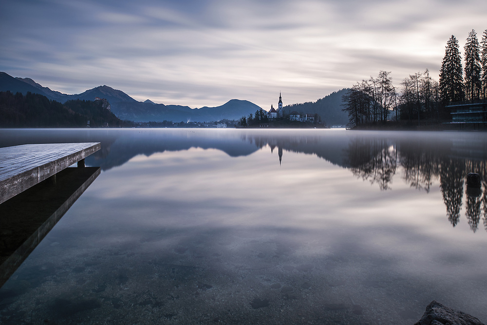 Misty dawn at Lake Bled, Slovenia with mountain backdrop
