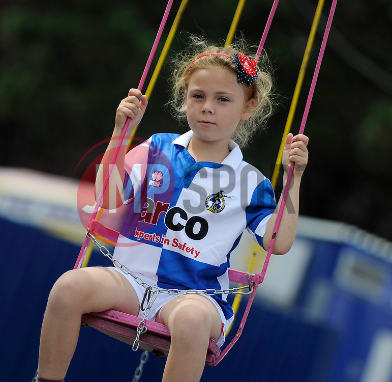 A girl wearing a new Bristol Rovers shirt goes on a swing at the Bristol Rovers Fun Day - Photo mandatory by-line: Dougie Allward/JMP - Mobile: 07966 386802 27/07/2014 - SPORT - FOOTBALL - Bristol - Bristol Rovers - - Memorial Stadium - Fun Day