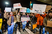 """Protesters outside Terminal 4 at the JFK Airport in New York. One protester holds a poster """"Jesus would be really pissed"""". The demonstrators partially shut down the terminal in protest of President Trump's immediate travel ban from seven predominately muslim countries."""