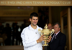 LONDON, ENGLAND - Sunday, July 3, 2011: Novak Djokovic (SRB) parades the trophy outside the Centre Court clubhouse after winning the Gentlemen's Singles Final match on day thirteen of the Wimbledon Lawn Tennis Championships at the All England Lawn Tennis and Croquet Club. (Pic by David Rawcliffe/Propaganda)