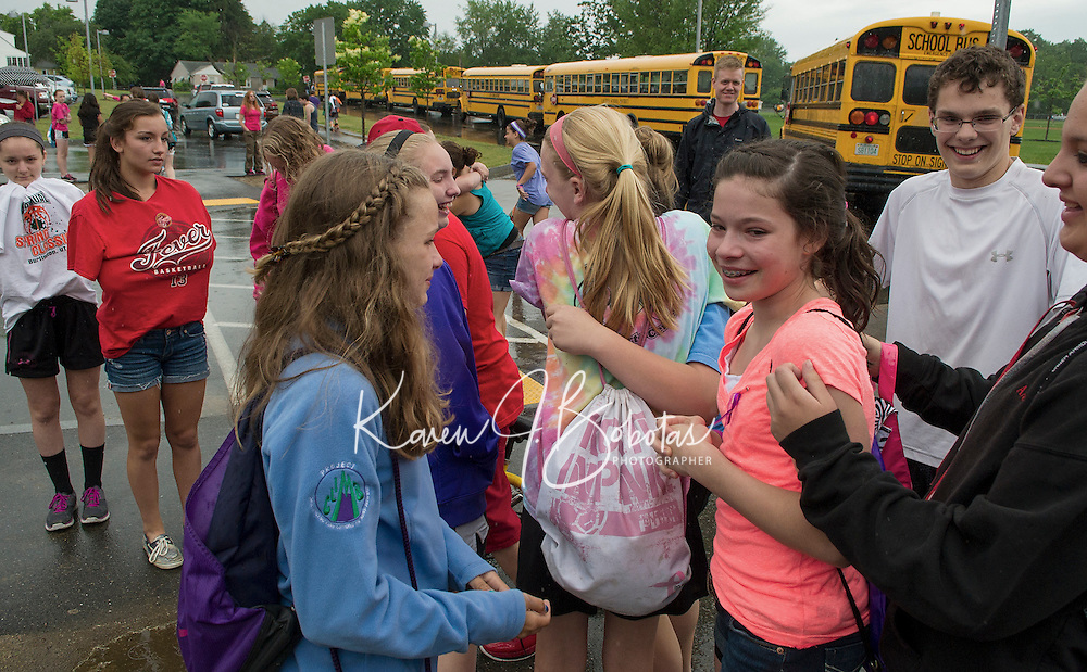 Hugs, smiles and tears as Laconia Middle School students end their final day on Tuesday afternoon.  (Karen Bobotas/for the Laconia Daily Sun)