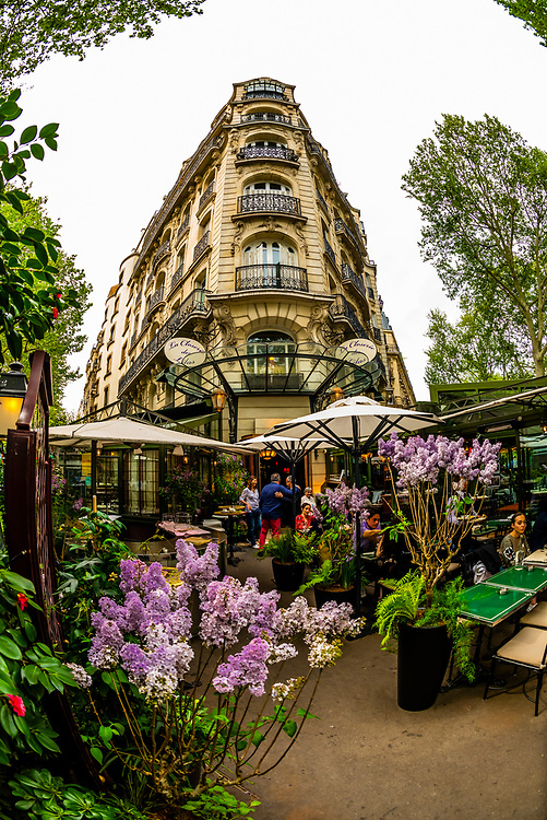 "The outdoor terrrace of La Closerie des Lilas (with pots of its namesake Lilacs), a cafe/brasserie/restauraunt on Boulevard Montparnasse, Paris, France. In the 1920's it was a haunt of writers such as Ernest Hemingway, Gertrude Stein and John Dos Passos. Hemingway mentioned the cafe in his book ""A Moveable Feast."""