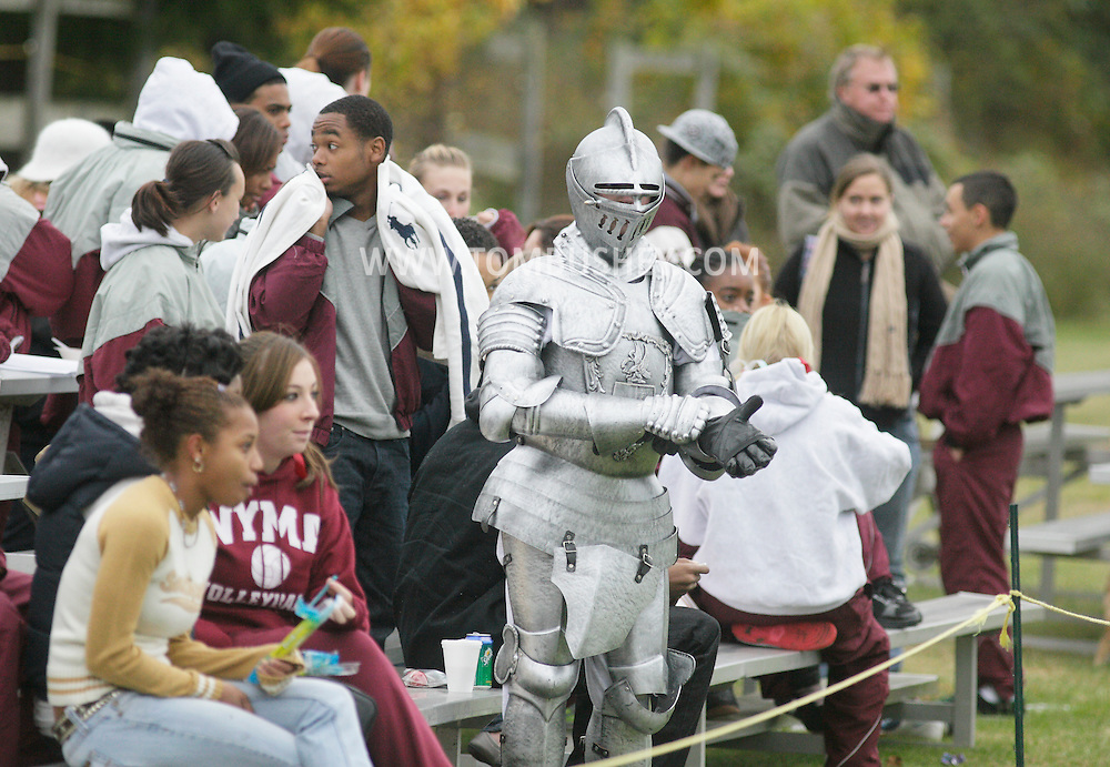 Cornwall-on-Hudson, New York - The New York Military Academy mascot, wearing a suit of armor, stands in front of fans in the bleachers during a high school football game against the Harvey School on Oct. 17, 2009.