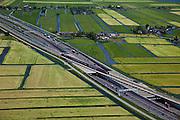 Nederland, Zuid-Holland, Hoogmade, 12-05-2009; kruising van de HSL-spoorlijn met Rijksweg A4, op het spoor rijdt een binnenlandse trein een proefrit. Het ligt in de bedoeling dat NS Hispeed gaat rijden over de HSL-Zuid, niet alleen naar het buitenland maar ook naar binnenlandse bestemmingen (Schiphol, Rotterdam, Breda).Swart collectie, luchtfoto (toeslag); Swart Collection, aerial photo (additional fee required).foto Siebe Swart / photo Siebe Swart