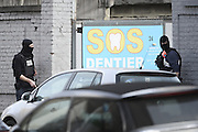 March 15, 2016 - Brussels, BELGIUM - <br /> <br /> Police pictured at the site of a shooting in the rue du Dries-Driesstraat in Forest-Vorst, Brussels, Tuesday 15 March 2016. The shooting took place during searches linked to the Paris terrorist attacks... Two members of federal police where injured in the operation and police is still searching for the shooter.<br /> ©Exclusivepix Media