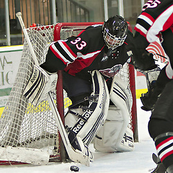 COBOURG, ON - Dec 8 : Ontario Junior Hockey League Game Action between Cobourg Cougar's Hockey Club & Pickering Panther's Hockey Club, during second period game action Pickering Panther's Hockey Club #33 protects the crease.(Photo by Dave Powers / OJHL Images)