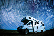A Mighty Campver Van is pictured beneath a sky full of stars at Aoraki Mackenzie International Dark Sky Reserve on New Zealand's South Island. The star trails are formed using a slow shutter effect on camera.
