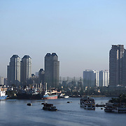 An early morning view of  Ho Chi Minh City and the Saigon River showing the port area and high rise buildings. Ho Chi Minh City, Vietnam. 3rd March 2012. Photo Tim Clayton
