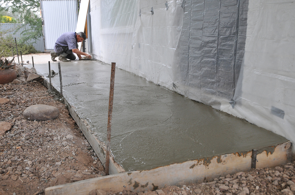 Finishing the concrete surface of my new front walk.