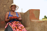 A proud member of Mashamba Village Pottery shows off her newly made pot. Limpopo, South Africa