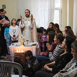 Father Remzi Diril, known as Father Adday, celebrates mass at an apartment in Kirsehir, Turkey.<br />