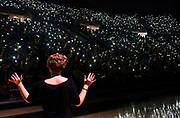 AUGUST 26, 2018  ATHENS, OHIO:<br /> New freshman students hold up their lit up cell phones as they answer questions prompted by the giant TV screens asking them to hold up their lights for yes answers to the questions asked during the freshman convocation in the Convocation Center at Ohio University on August 26, 2018 in Athens, Ohio.