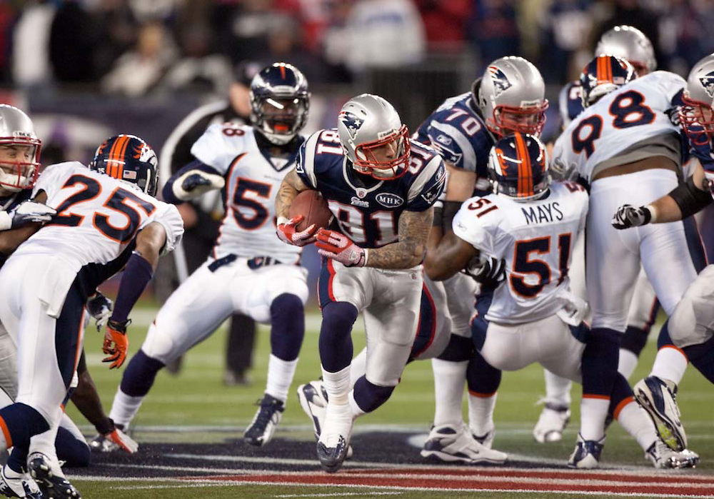 Foxborough, MA 01/14/2012.Patriots tight end Aaron Hernandez breaks through the Broncos' defense in the first half of Saturday's AFC Divisional game between the New England Patriots and the Denver Broncos..Wicked Local Photo by Alex Jones