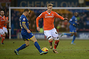 Barry Fuller (Captain) of AFC Wimbledon and Luton Town striker Joe Pigott during the Sky Bet League 2 match between AFC Wimbledon and Luton Town at the Cherry Red Records Stadium, Kingston, England on 13 February 2016. Photo by David Vokes.