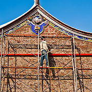 Workers renovate the side of Tainan's Martial Temple, Taiwan