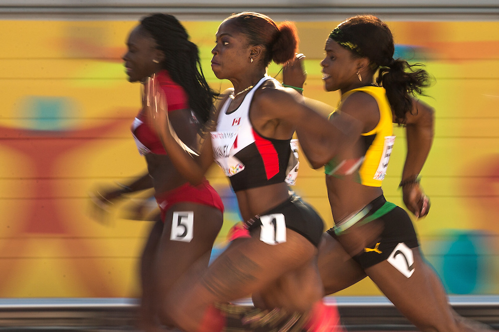 Crystal Emmanuel of Canada run in the semifinals of the women's 100 metres at the CIBC Athletics Stadium at the 2015 Pan American Games in Toronto, Canada, July 22,  2015.  AFP PHOTO/GEOFF ROBINS