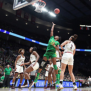 March 31, 2019; Portland, OR, USA;  Oregon Ducks forward Ruthy Hebard (24) shoots over Mississippi State Bulldogs in the Elite Eight of the NCAA Women's Tournament at Moda Center.<br /> Photo by Jaime Valdez