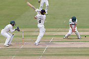 Tom Smith pulls for 4 past Hassan Azad during the Specsavers County Champ Div 2 match between Gloucestershire County Cricket Club and Leicestershire County Cricket Club at the Cheltenham College Ground, Cheltenham, United Kingdom on 16 July 2019.