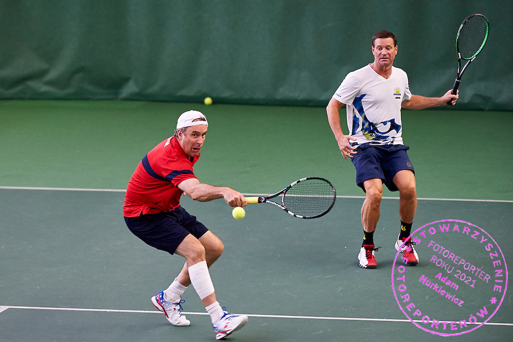 Helsinki, Finland - 2016 June 28: Mitchell Perkins (left) and Ken White both from USA in action while tennis smatch MD50 - Doubles Main Draw during 36th ITF Seniors World Individual Championships 2016 at Talin Tenniskeskus on June 28, 2016 in Helsinki, Finland.<br /> <br /> Adam Nurkiewicz declares that he has no rights to the image of people at the photographs of his authorship.<br /> <br /> Picture also available in RAW (NEF) or TIFF format on special request.<br /> <br /> Any editorial, commercial or promotional use requires written permission from the author of image.<br /> <br /> Mandatory credit:<br /> Photo by &copy; Adam Nurkiewicz