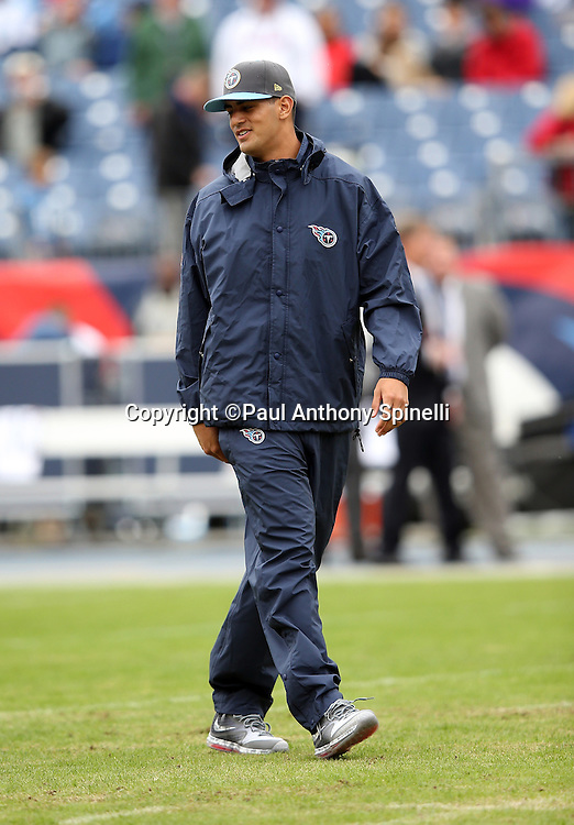Tennessee Titans quarterback Marcus Mariota (8) looks on while inactive with an injury during pregame warmups before the 2015 week 7 regular season NFL football game against the Atlanta Falcons on Sunday, Oct. 25, 2015 in Nashville, Tenn. The Falcons won the game 10-7. (©Paul Anthony Spinelli)