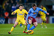 AFC Wimbledon midfielder Jake Reeves (8) closes down Scunthorpe United defender Scott Wiseman (2)  during the EFL Sky Bet League 1 match between Scunthorpe United and AFC Wimbledon at Glanford Park, Scunthorpe, England on 28 February 2017. Photo by Simon Davies.