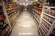 (MODEL RELEASED IMAGE). Craig Caven shopping for a weeks' worth of food at Raley's, a California grocery chain. (Supporting image from the project Hungry Planet: What the World Eats.) The Caven family of American Canyon, California, is one of the thirty families featured, with a weeks' worth of food, in the book Hungry Planet: What the World Eats.