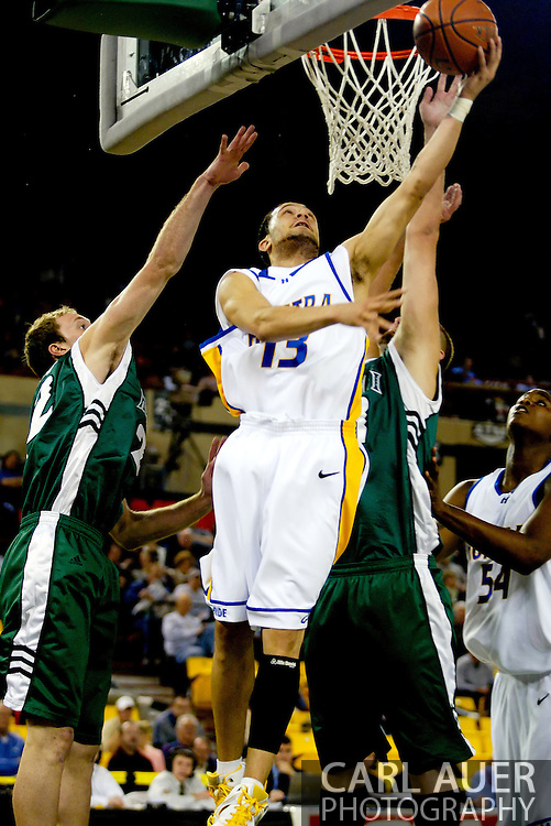 11/23/2006 - Anchorage, Alaska: Junior guard Antoine Agudio (13) of the Hofstra Pride attempts a reverse lay-up against the Warrior defense as Hawaii defeats Hofstra 80-79 at the 2006 Great Alaska Shootout on Thanksgiving night<br />