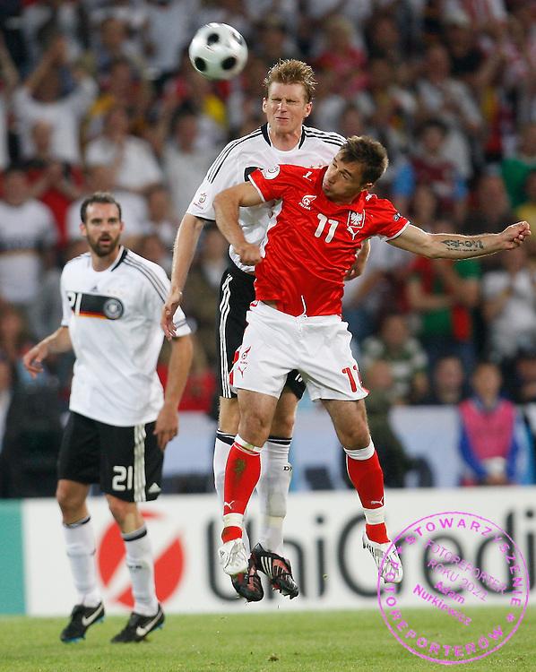 KLAGENFURT 08/06/2008.Euro 2008 - Group B.GERMANY v POLAND.PER MERTESACKER OF GERMANY GOES UP FOR A HEADER WITH MAREK SAGANOWSKI OF POLAND , IN THE BACKGROUND CHRISTOPH METZELDER .. *****************.FOT. PIOTR HAWALEJ / WROFOTO