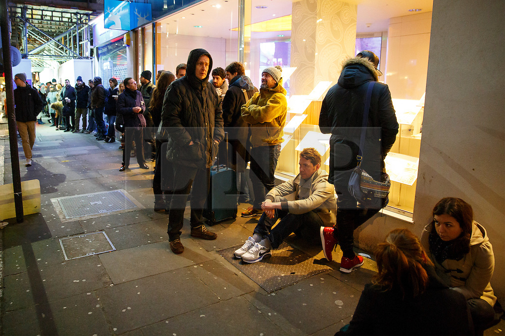 © Licensed to London News Pictures. 16/01/2015. LONDON, UK. People queuing in early morning outside 'The French Bookshop' in London to buy a copy of Charlie Hebdo's survival edition on Friday, 16 January 2015. Photo credit : Tolga Akmen/LNP