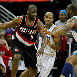 January 16, 2012; New Orleans, LA, USA; Portland Trail Blazers point guard Raymond Felton (5) is guarded by New Orleans Hornets power forward Carl Landry (24) during the first quarter of a game at the New Orleans Arena.   Mandatory Credit: Derick E. Hingle-US PRESSWIRE
