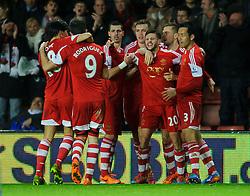 Southampton Forward Adam Lallana (ENG) celebrates scoring a goal to level the game at 2-2 - Photo mandatory by-line: Rogan Thomson/JMP - Tel: Mobile: 07966 386802 - 28/01/2014 - SPORT - FOOTBALL - St Mary's Stadium - Southampton v Arsenal - Barclays Premier League.