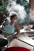 Luciana B. Vasconcelos, 58, works with the family in one of the last houses of flour in Sapê From The North, as this Afro-Descendant place is called.<br /> Afro-Descendant Community Angelim I Itaúnas town, Espírito Santo State - Brazil.<br /> <br /> Luciana B. Vasconcelos, 58 anos,  trabalha com a família em uma das últimas casas de farinha do Sapê do Norte, como é chamado esse lugar de quilombos.<br /> Comunidade Quilombola Angelim I, Itaúnas, Espírito Santo - Brasil.
